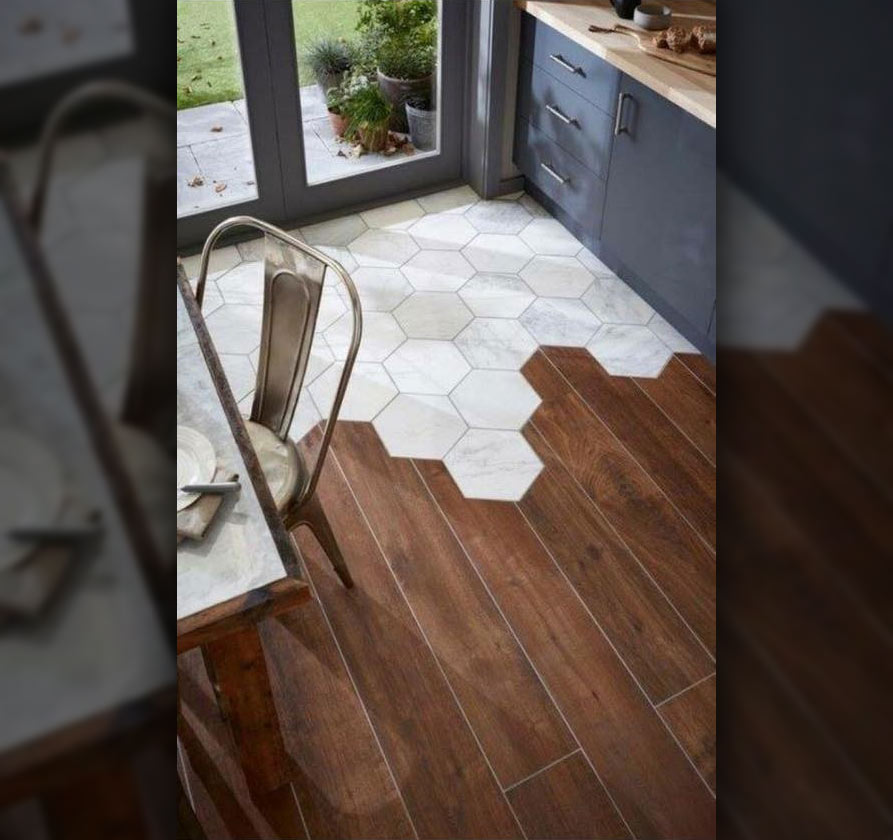 Modern kitchen floor with a combination of white tile and hardwood flooring.